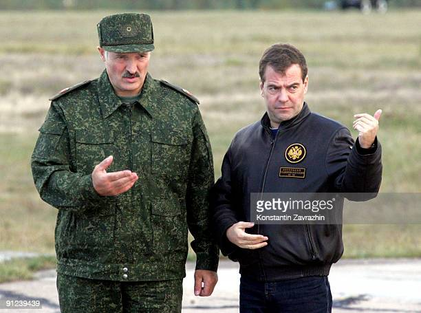 Russian President Dmitry Medvedev and Belarusian President Alexander Lukashenko arrive at the military polygon to watch combined military exercises...
