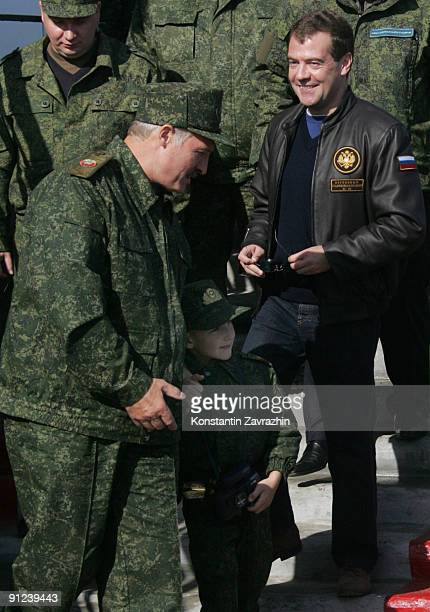 Russian President Dmitry Medvedev and Belarusian President Alexander Lukashenko and his 5-year-old son Nikolai Lukashenko arrive at the military...