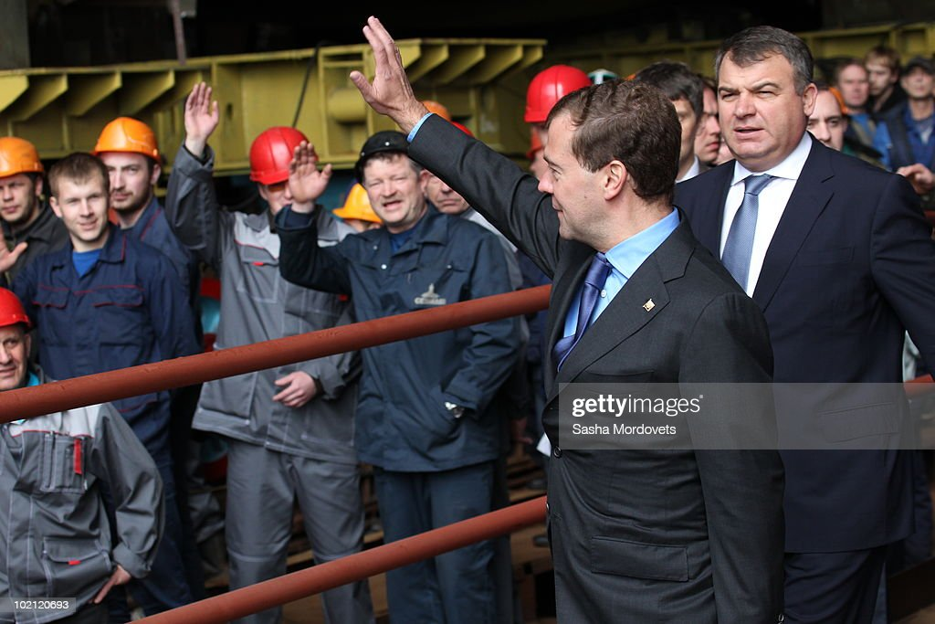Russian President Dmitry Medvedev (C) and Defense Minister Anatoliy Serdyukov (R) greet workers during a ceremony to launch the multipurpose nuclear submarine 'Severodvinsk' at the Sevmash shipyard June 15, 2010 in the Northern Russian city of Severodvinsk in Arkhanguelsk region, Russia. The 'Severodvinsk' submarine, which carries 24 cruise missiles, was launched after a short delay caused by technical reasons.