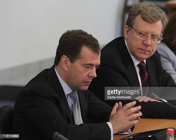 Russian President Dmitry Medvedev and Finance Minister Alexey Kudrin visit the Lytkarino Optical Glass Factory on April 27 2011 in the town of...