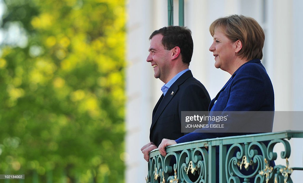 Russian President Dmitry Medvedev and German Chancellor Angela Merkel look on at Meseberg Palace, the government's official residence, in the eastern German town of Meseberg on June 4, 2010. Medvedev is in Germany for two days of what the German government called 'informal' discussions set to be dominated by Iran's nuclear programme and the Middle East.