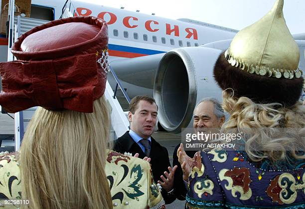 Russian President Dmitry Medvedev and head of the Republic of Tatarstan Mintimer Shaimiyev meet with women in traditional Tatar clothing upon...