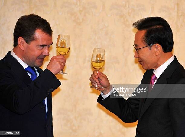 Russian President Dmitry Medvedev and his South Korean counterpart Lee MyungBak raise their glasses during a dinner at the presidential Cheong Wa Dae...