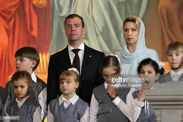 Russian President Dmitry Medvedev and his wife Svetlana Medvedeva attend Christmas Mass in the Cathedral of Christ the Saviour on January 6 2012 in...