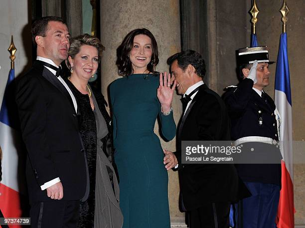 Russian President Dmitry Medvedev and his wife Svetlana Medvedeva arrive to attend a state dijnner in their honour hosted by French President Nicolas...