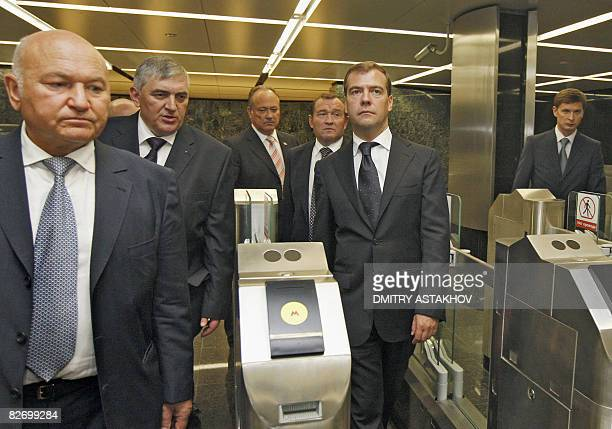 Russian President Dmitry Medvedev and Moscow Mayor Yury Luzhkov visit a new metro station in Moscow on September 7 on City Day during celebrations...