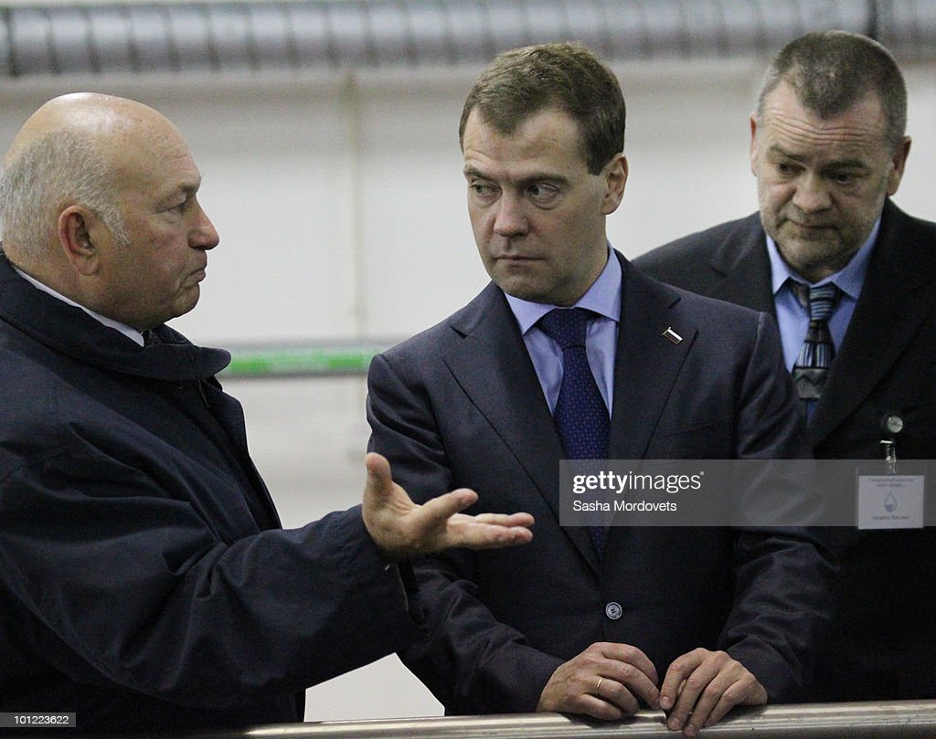 Russian President Dmitry Medvedev and Moscow's Mayor Yuri Luzhkov (L) visit a waterworks in Vnukovo on May 27, 2010 outside Moscow in Russia.