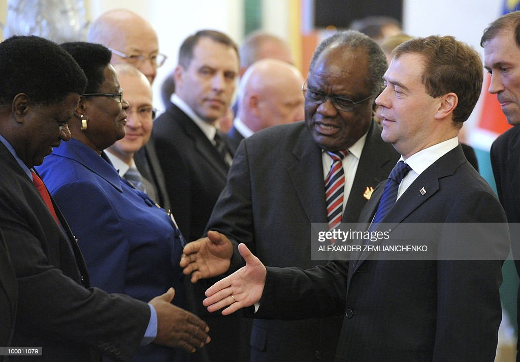 Russian President Dmitry Medvedev (R) and Namibian President Hifikepunye Pohamba (2R) greet Namibian diplomats before their talks at the Kremlin in Moscow on May 20, 2010. Russia and Namibia signed an agreement on exploration and production of uranium which could lead to Moscow investing one billion dollars in the resource-rich southern African country, officials said.