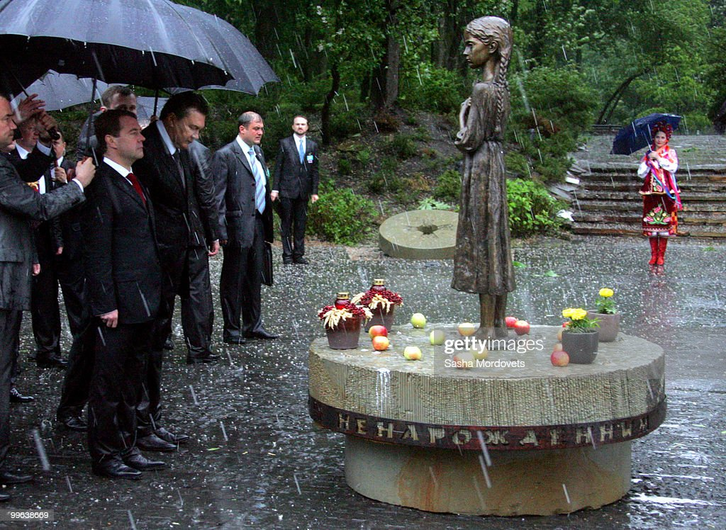 Russian President Dmitry Medvedev (2nd L) and President of Ukraine Viktor Yanukovych (3rd L) place flowers at the monument to the millions of victims of the 1932-1933 Soviet famine known as Golodomor on May 17, 2010 in Kiev, Ukraine. Medvedev is in the Ukraine as part of a two-day state visit to improve relations with the former Soviet republic and hammer out a series of agreements with the recently elected Ukrainian President Viktor Yanukovych.