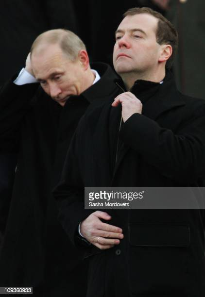 Russian President Dmitry Medvedev and Prime Minister Vladimir Putin attend a wreath-laying ceremony at the Tomb of the Unknown Soldier at the Kremlin...