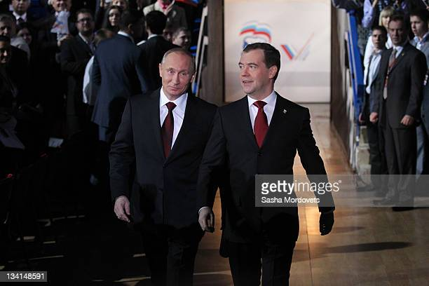 Russian President Dmitry Medvedev and Prime Minister Vladimir Putin arrive to the congress of the United Russia Party November 2011 in Moscow Russia...