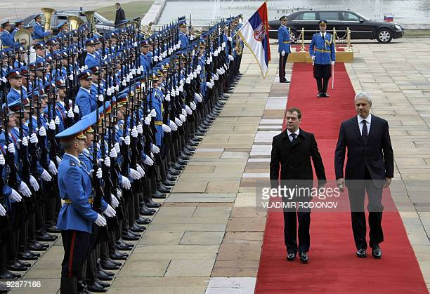 Russian President Dmitry Medvedev and Serbian President Boris Tadic walk past a Serbian honor guard upon Medvedev's arrival to Belgrade on October 20...