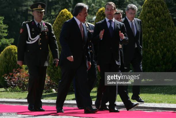 Russian President Dmitry Medvedev and Turkish President Abdullah Gul review a guard of honour on May 12 2010 in Ankara Turkey Medvedev is on a twoday...