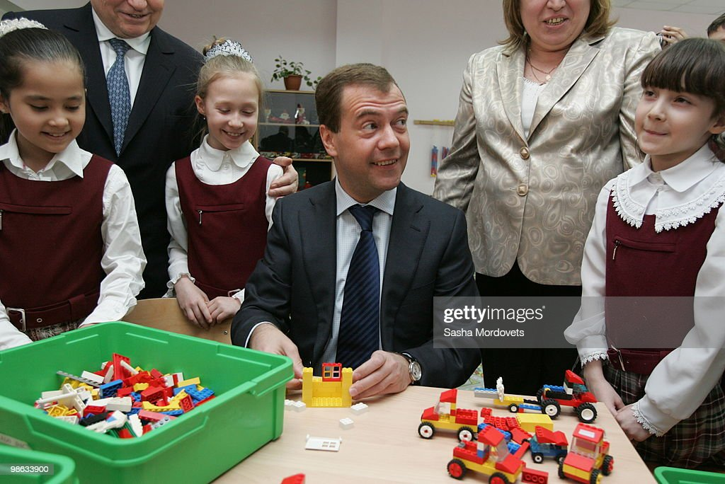 Russian President Dmitry Medvedev builds a LEGO toy house with children as he visits a school on April 23, 2010 in Moscow, Russia.