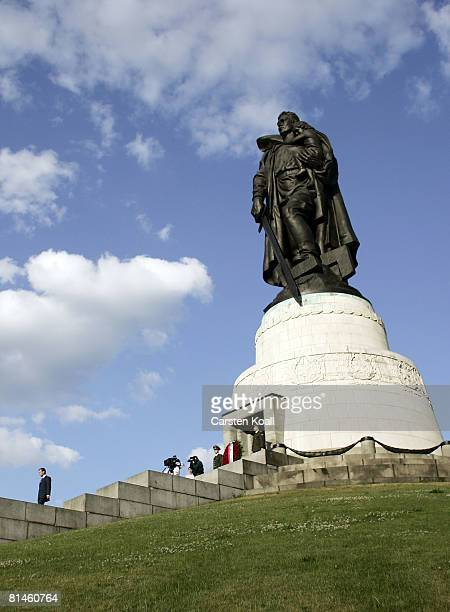 Russian President Dmitry Medvedev climbs down after he layed down flowers at the soviet war memorial on June 5 2008 in Berlin Germany It is Medvedevs...