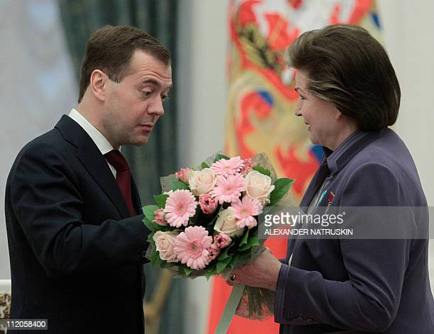 Russian President Dmitry Medvedev congratulates Soviet cosmonaut the first woman in space Valentina Tereshkova who received the medal 'For Merits in...