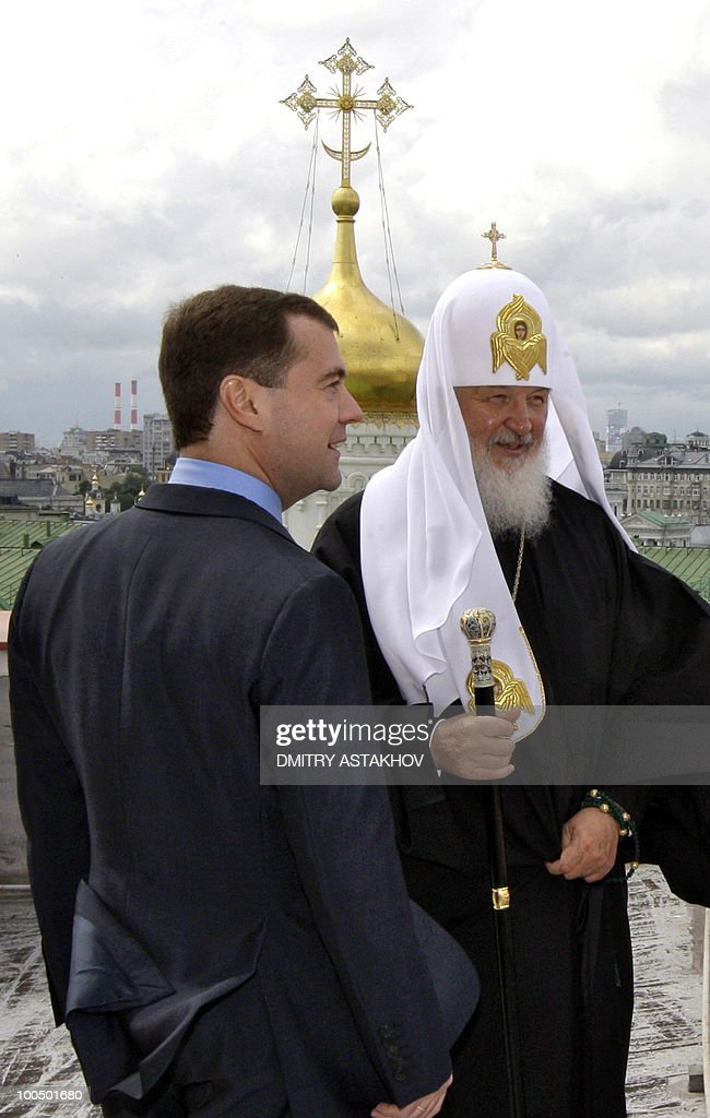 Russian President Dmitry Medvedev (L) Ecumenical Patriarch Bartholomew I, not pictured, and Russian Orthodox Patriarch Kirill (R) stand on the roof of a building at the Kremlin in Moscow on May 25, 2010. Patriarch Bartholomew I is on a visit to Moscow expected to last several days.