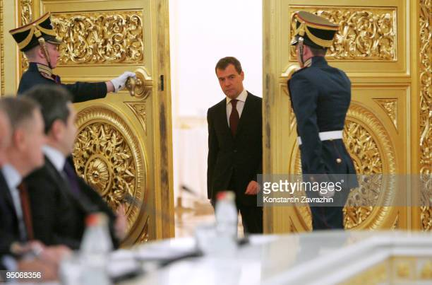 Russian President Dmitry Medvedev enters the hall for the start of a State Council Session at the Kremlin on December 23 2009 in Moscow Russia The...