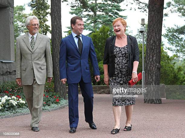 Russian President Dmitry Medvedev Finland's President Tarja Halonen and her husband Juris Doktor Pentti Arajarvi are seen during their meeting on...