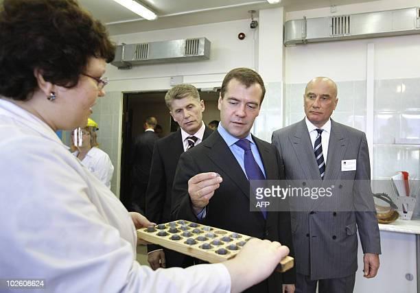Russian President Dmitry Medvedev flanked by Amur region governor Oleg Kozhemyako and board chairman of the Petropavlovsk managing company Pavel...