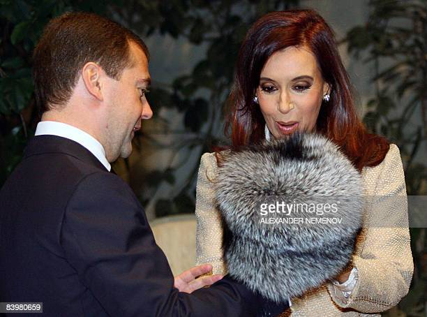 Russian President Dmitry Medvedev gives a traditional Russian fur hat shapka to Argentine President Cristina Kirchner at the Kremlin in Moscow on...