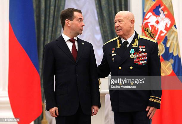 Russian President Dmitry Medvedev greets Russian cosmonaut and astronaut Alexei Leonov during an awards ceremony devoted to achievements in the space...