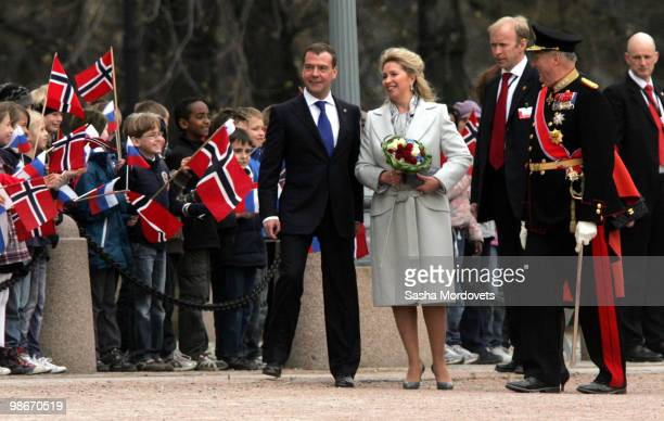 Russian President Dmitry Medvedev his wife Svetlana and King Harald V of Norway attends the official welcome ceremony for the Medevedevs outside the...