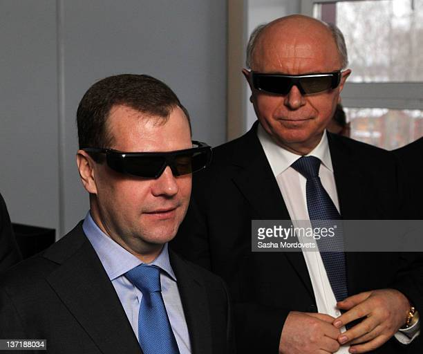 Russian President Dmitry Medvedev holds a 3D glasses along with Governor of Mordovia Nikolay Merkushkin during his visit to the new technologies...