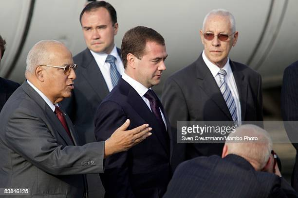 Russian President Dmitry Medvedev is welcomed by Ricardo Cabrisas Vice President of the Council of Ministers in Cuba upon Medvedev's arrival at Jose...