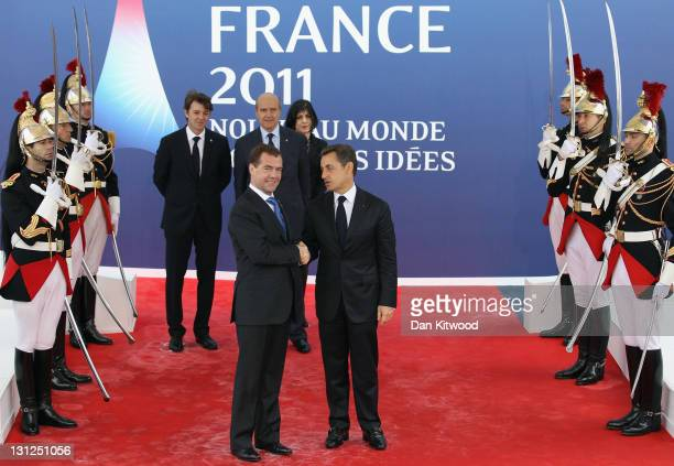 Russian President Dmitry Medvedev is welcomed by the French President Nicolas Sarkozy to the G20 Summit on November 3 2011 in Cannes France World's...