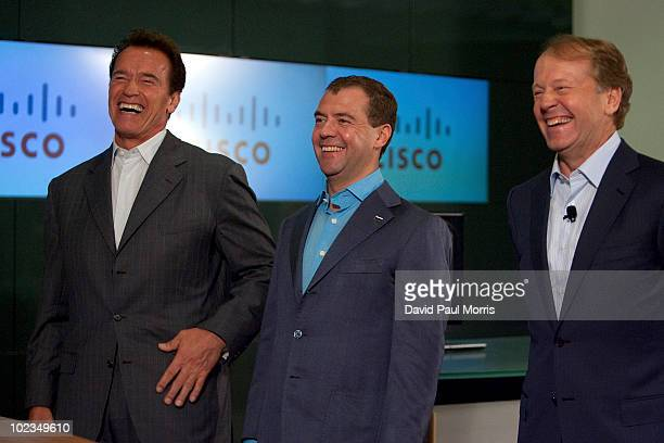 Russian President Dmitry Medvedev laughs with Cisco Chairman and CEO John Chambers and California Gov Arnold Schwarzenegger during a demonstration at...