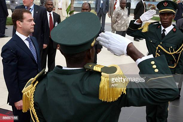 Russian President Dmitry Medvedev lays a wreath at the memorial to Angola's first president Antonio Agostinho Neto in Luanda on June 26 2009 Medvedev...