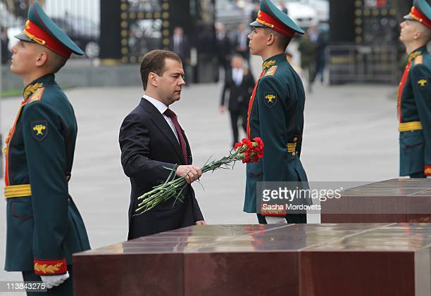 Russian President Dmitry Medvedev lays flowers as he attends a wreath laying ceremony near the Tomb of Unknown Soldier on May 8, 2011 in Moscow,...