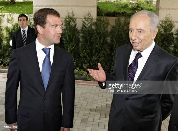 Russian President Dmitry Medvedev listens to his Israeli counterpart Shimon Peres during their meeting at the Bocharov Ruchei residence in Sochi on...