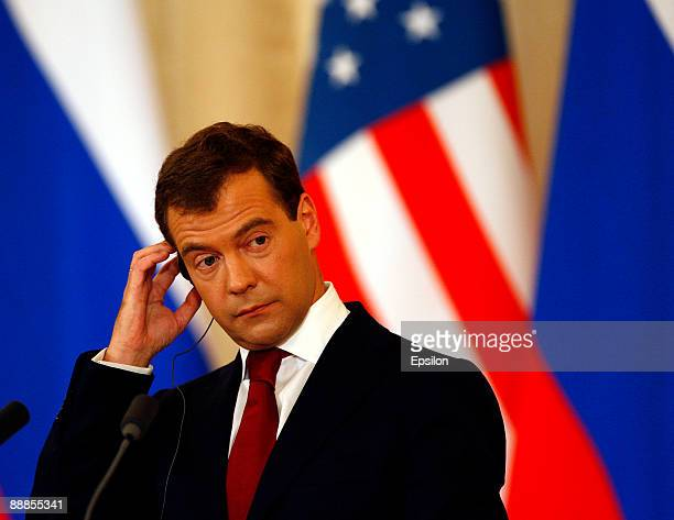 Russian President Dmitry Medvedev listens to translation during a press conference with US President Barack Obama after the signing ceremony of the...