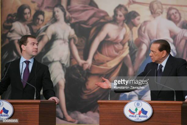 Russian President Dmitry Medvedev listens while Italian Prime Minister Silvio Berlusconi speaks during a joint press conference at Villa Madama on...