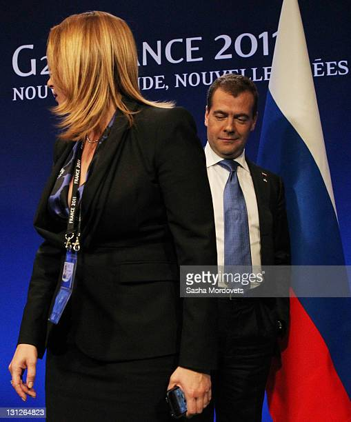 Russian President Dmitry Medvedev looks at his press secretary Natalya Timakova as he arrives for his press conference at the G20 Summit on November...