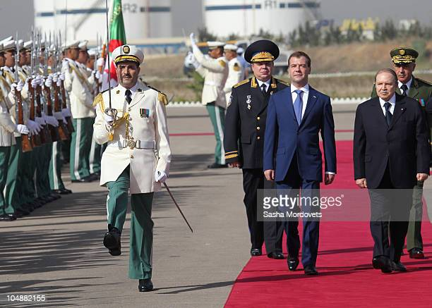 Russian President Dmitry Medvedev meets Algerian President Abdelaziz Bouteflika during a welcoming ceremony October 6 2010 in Algiers Algeria...