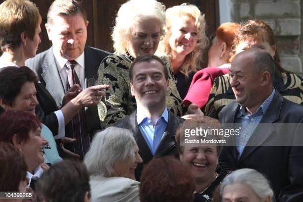 Russian President Dmitry Medvedev meets elderly people in Kursk as the Governor of Kursk region Alexander Mikhailov looks on on September 24 500 km...