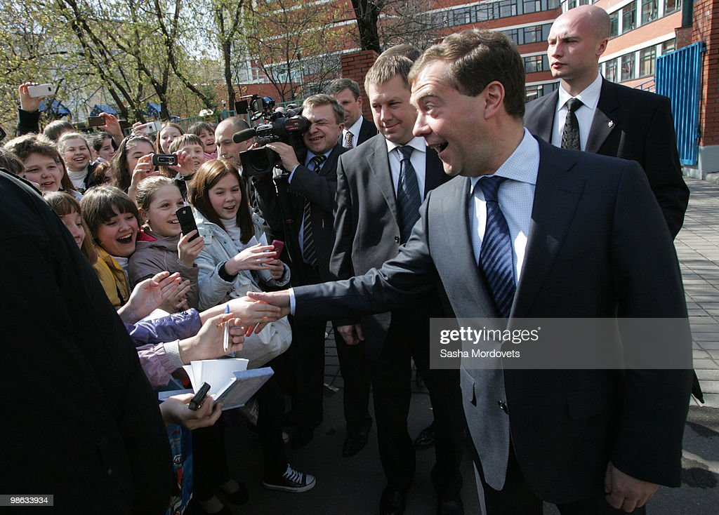 Russian President Dmitry Medvedev meets with children as he visits a school on April 23, 2010 in Moscow, Russia.
