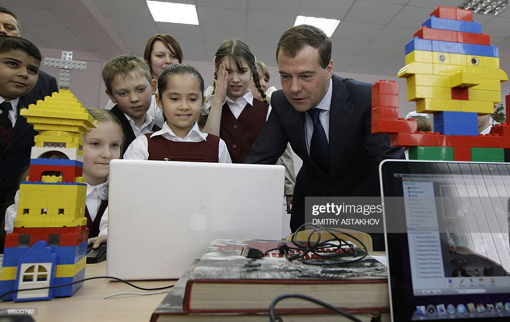 Russian President Dmitry Medvedev (R) plays with the pupils of 627th Education Center in a Lego class in Moscow on April 23, 2010.
