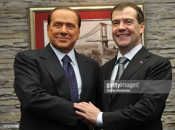 Russian President Dmitry Medvedev receives Italian Prime Minister Silvio Berlusconi at the Krasnaya Polyana resort on December 3 2010 in Sochi Russia...