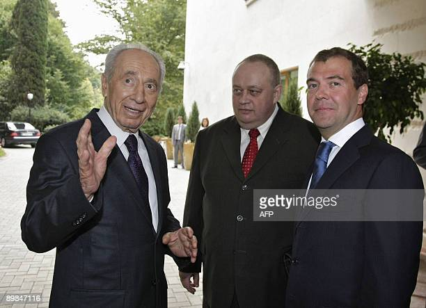 Russian President Dmitry Medvedev shakes hands with his Israeli counterpart Shimon Peres during their meeting at the Bocharov Ruchei residence in...