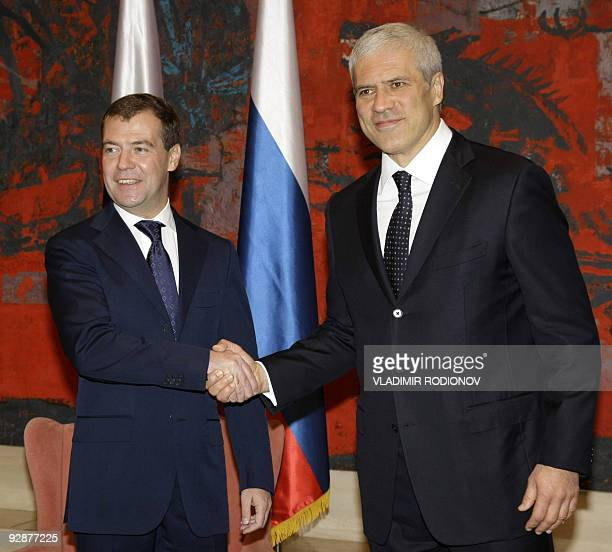 Russian President Dmitry Medvedev shakes hands with Serbian President Boris Tadic in Belgrade on October 20 2009 Medvedev arrived in Belgrade on a...