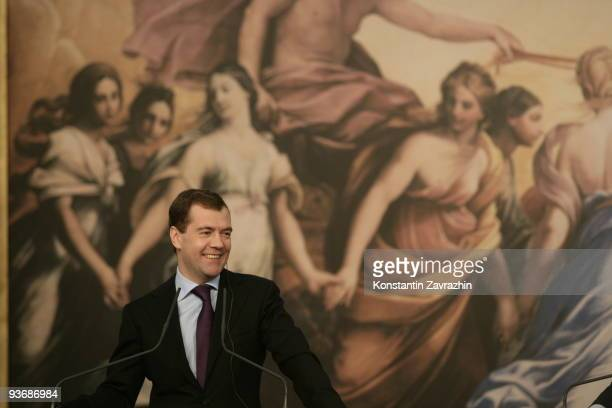 Russian President Dmitry Medvedev smiles while attending a joint press conference with Italian Prime Minister Silvio Berlusconi at Villa Madama on...