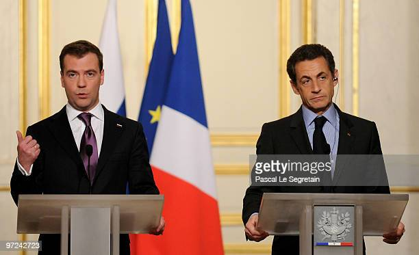 Russian President Dmitry Medvedev speaks beside French President Nicolas Sarkozy during a press conference following their meeting at Elysee Palace...