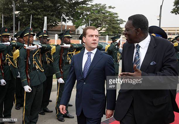 Russian President Dmitry Medvedev speaks with Angolan Foreign Minister Assuncao Afonso de Sousa dos Anjos upon his arrival in Luanda on June 26 2009...