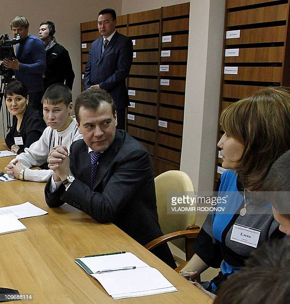 Russian President Dmitry Medvedev speaks with unemployed people on March 1 2011 during a meeting in a library in Elista the capital of the Kalmykia...