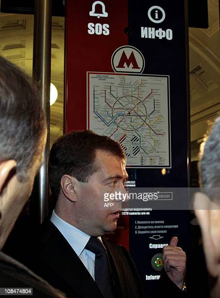 Russian President Dmitry Medvedev stands in front of a subway map at the Okhotny Ryad subway station in Moscow on January 27 2011 President Dmitry...