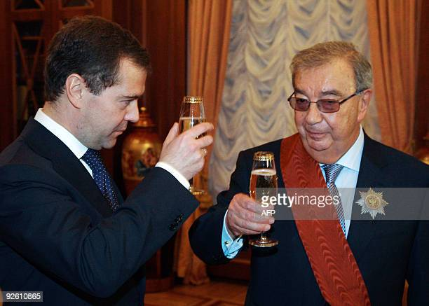 Russian President Dmitry Medvedev toasts with former prime minister Yevgeny Primakov in Moscow on October 29, 2009 to celebrate Primakov's 80th...